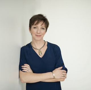 Caroline Malloy, Ph.D. headshot in blue