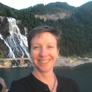 Caroline Mallot Ph.D. historian in front of Norway waterfall